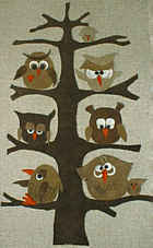 Owls on a tree, leather